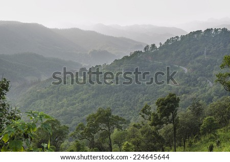 Mountains covered with a thin mist. In northern Thailand