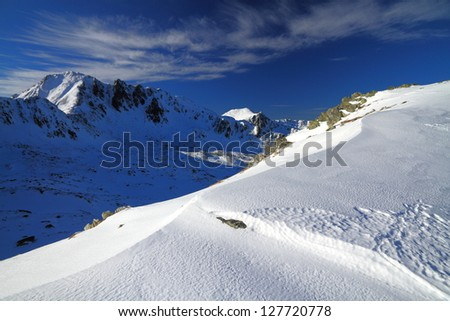 Mountains covered with snow in the winter - stock photo