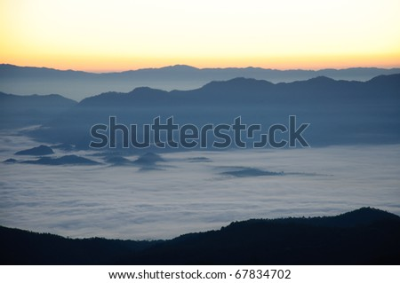 Mountains in a fog at sunraise