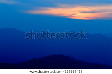 mountains in a fog,thailand - stock photo