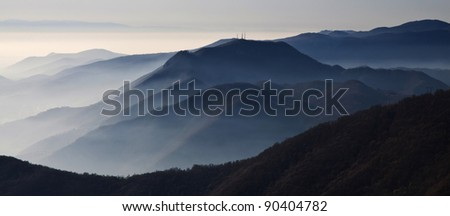 Mountains in autumn with fog