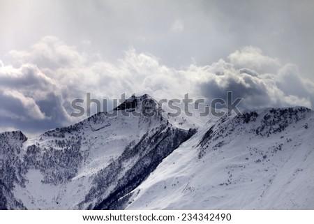 Mountains in evening cloudy sky. Caucasus Mountains, Georgia. Ski resort Gudauri. - stock photo