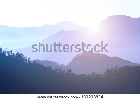 Mountains in morning fog - stock photo