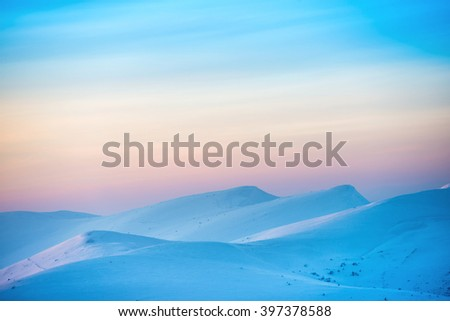 Mountains in snow. Landscape with sunset over hills - stock photo
