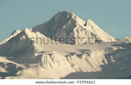 Mountains in snow on a sunset. Alaska. - stock photo