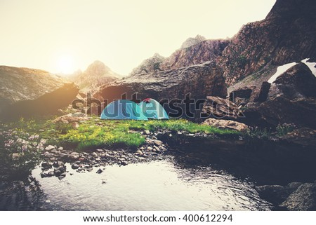 Mountains Landscape and tents camping Travel Lifestyle concept Summer vacations outdoor - stock photo