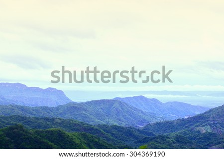 Mountains landscape in cloudy day. - stock photo