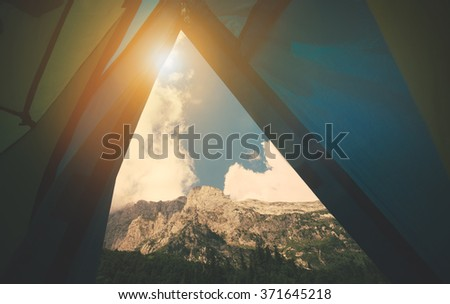 Mountains Landscape view from tent camping entrance Travel Lifestyle concept Summer vacations outdoor - stock photo