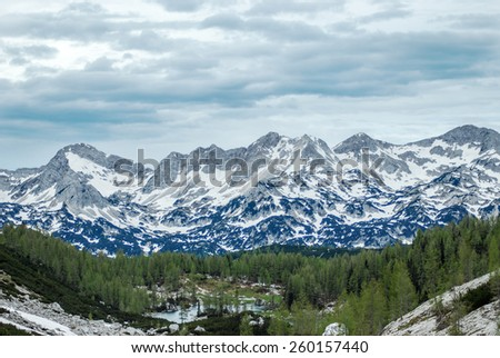 Mountains landscape with blue sky and snow - stock photo