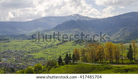 Mountains, meadows and lawns, summer forest and clouds. Family vacation in the mountains - stock photo