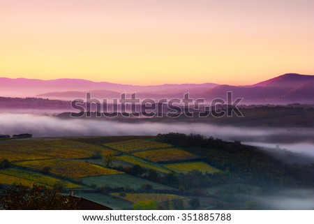 Mountains of Beaujolais with first morning lights, France - stock photo