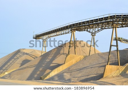 Mountains of sand and gravel in the gravel pit - stock photo