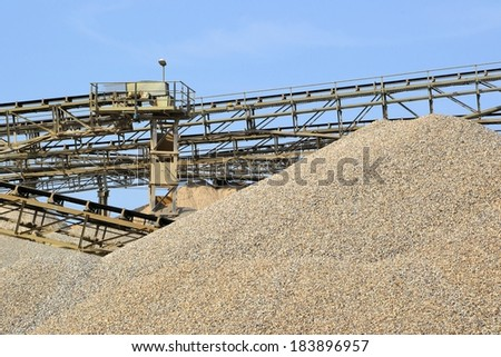 Mountains of sand and gravel in the gravel pit