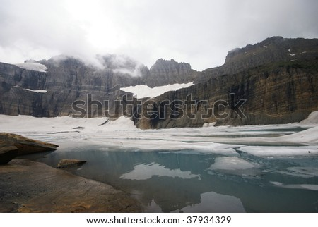 Mountains over Icy Glacial Lake - stock photo