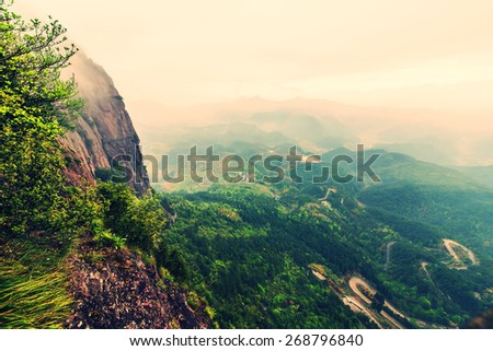 Mountains overlooking the highway - stock photo