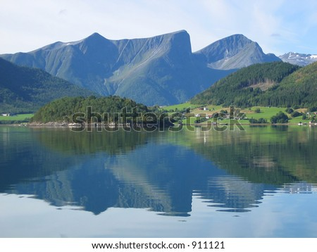 Mountains reflecting in the fjord near Andalsness, Norway