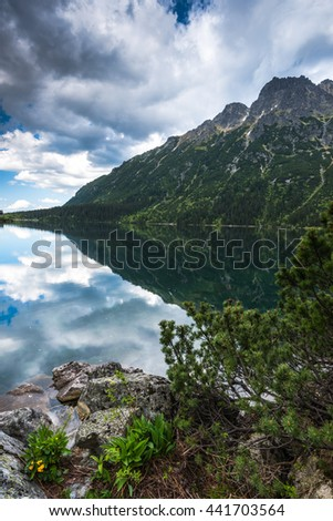 Mountains reflection on lake surface in Poland. - stock photo