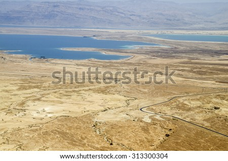 Mountains, rocks and hills of Judean desert in Israel, Middle East landmarks of Old Testament Bible times. Aerial view of Dead sea spa and recreation areas - stock photo