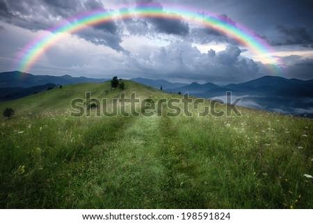Mountains rural landscape rainy landscape - stock photo