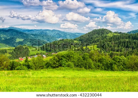 Mountains scenery. Panorama of grassland and forest in Beskid Sadecki mountains. Carpathian mountains landscape, Poland. - stock photo