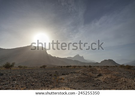 Mountains with gravel desert, Oman - stock photo
