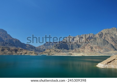 Mountains with lake in Oman - stock photo