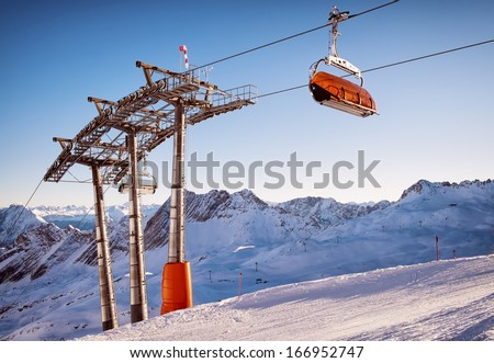 mountains with modern ski lift chair