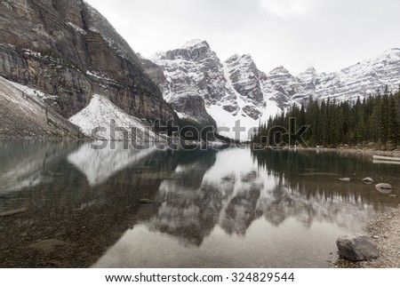 Mountains with reflexion in Moraine lake, Banff National Park, Alberta, Canada - stock photo