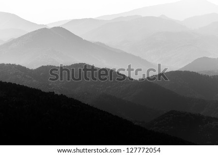 Mountains with strange dramatic sky - stock photo