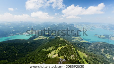 Mountaintop view over lakes Wolfgangsee (left) and Mondsee (right) in Austria. Photographed from the Schafberg mountaintop. - stock photo