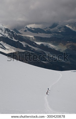 Mountaneers on glacier with Monte Rosa in backgroud