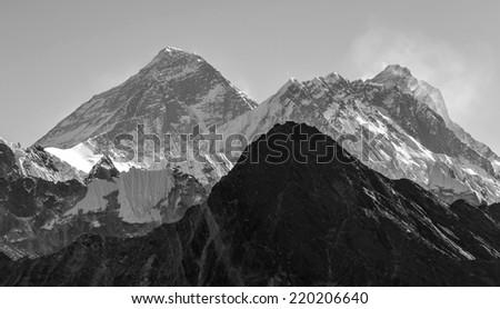 Mounts Everest (8848 m) and Lhotse (8516 m) from the Ngozumba Tsho (the fifth Gokyo lake) - Nepal, Himalayas (black and white) - stock photo