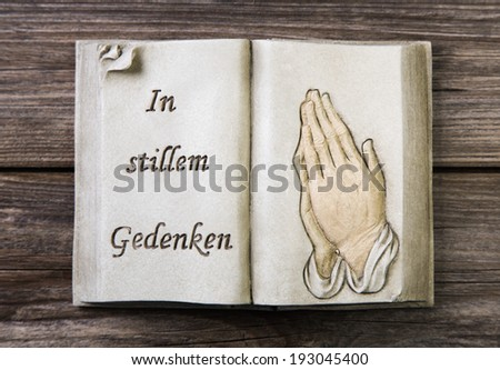 "Mourning: Praying hands - decoration with german text ""thinking of you in silence"" - stock photo"