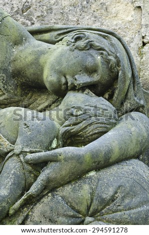 Mourning statue of Mother and child - old cemetery at Krasna Lipa, Czech republic, Europe - stock photo