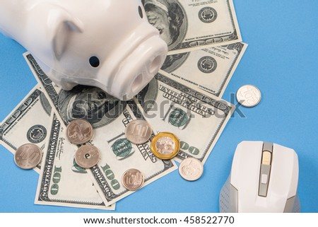 mouse computer and piggy coin saving, blue background, save money concept. - stock photo