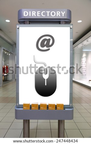Mouse symbol and direction sign inside shopping mall.  - stock photo
