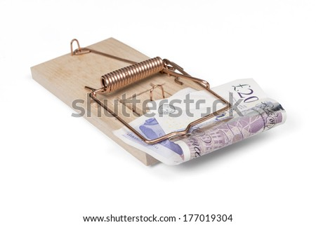 Mouse trap with British pounds, isolated over white with clipping path. - stock photo