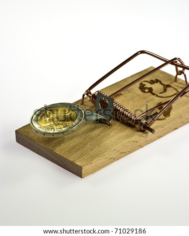 Mouse trap with Euro coin on white background