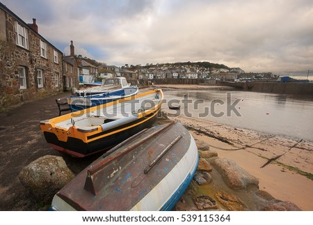Mousehole: a small picturesque village near Penzance (Cornwall, England). Fishing boats on foreground.