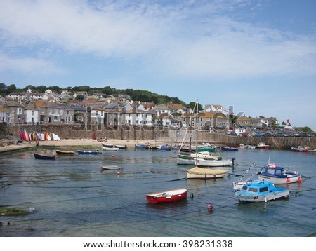 Mousehole, Cornwall, UK - July 11, 2015: A small harbour in the Cornish village of Mousehole in the summer