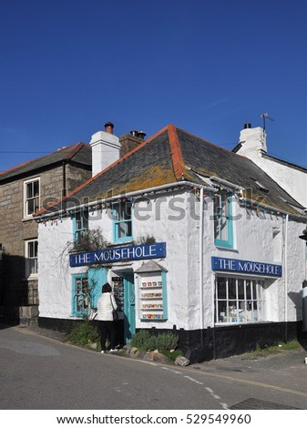 MOUSEHOLE, UK - OCTOBER 31, 2016. An old tourist gift shop in the tiny village and fishing port of Mousehole, located in west Cornwall, England, UK.