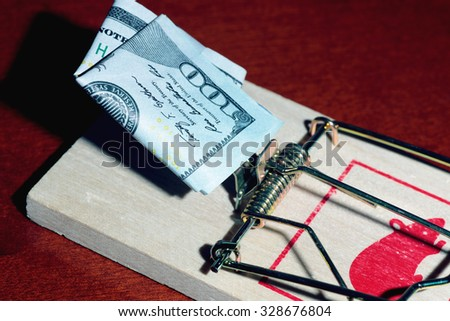 Mousetrap with dollars - stock photo