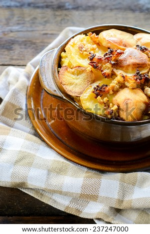 Moussaka in the old brown bowl with baked potato on top,selective focus  - stock photo
