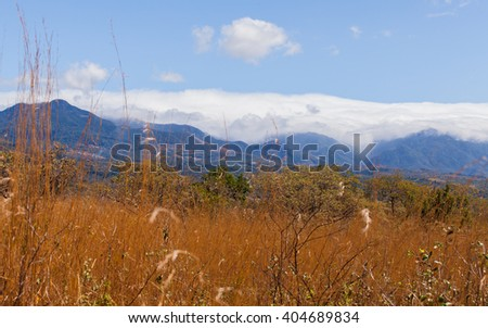 Moutain with blue sky and clouds - stock photo