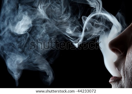 Mouth exhaling cigarette smoke on black background