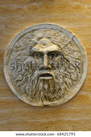 Mouth of Truth (Bocca della Verita) - contemporary replica on stone wall - stock photo