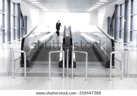 Movable conveyor belt in airport, escalator line - stock photo