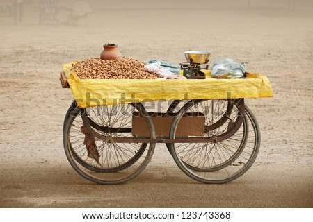 Movable counter to sell roasted peanuts. India, Rajasthan. - stock photo