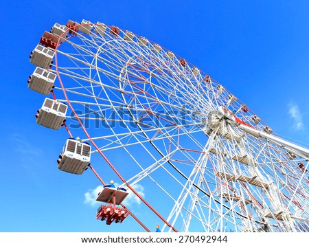 Movable ferris wheel without people in the city park - stock photo