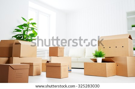 move. lots of cardboard boxes in an empty new apartment - stock photo